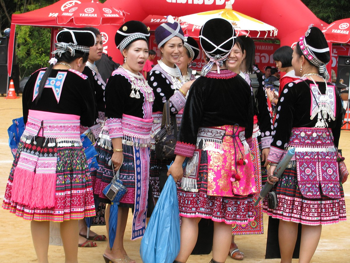H'mong women wearing batiked and embroidered traditonal pleated skirts at New Year, Thailand
