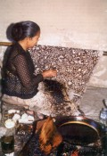 Javanese woman working using a canting